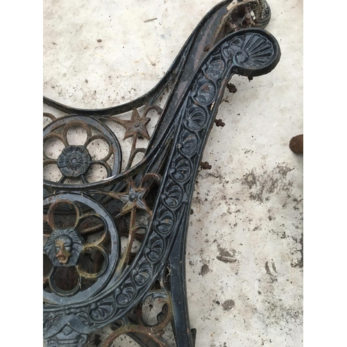 1056 - A PAIR OF CAST IRON BENCH ENDS...