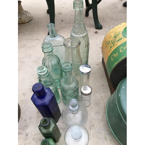 1070A - A COLLECTION OF VINTAGE GLASS BOTTLES...
