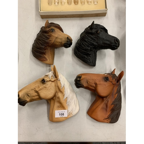 108 - FOUR BOSSONS HORSE HEAD PLAQUES...