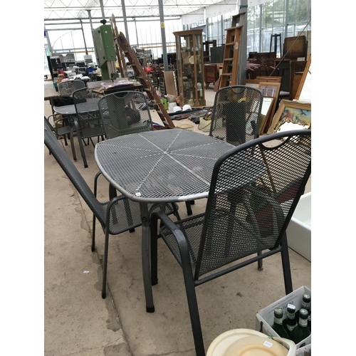 1091 - A METAL RECTANGULAR GARDEN TABLE WITH FOUR MATCHING CHAIRS...