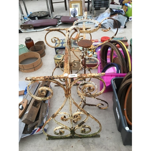 1096 - A WROUGHT IRON TABLE BASE AND A PLANT STAND...