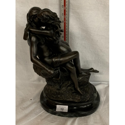 12 - A LARGE RESIN FIGURE OF A LOVING COUPLE...