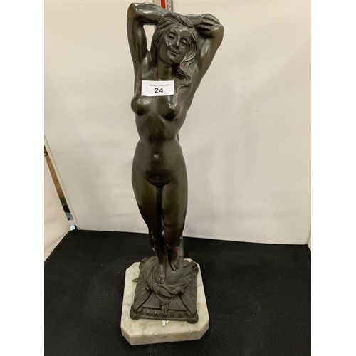 24 - A SIGNED SPELTER FIGURE OF A NUDE WOMAN ON A MARBLE BASE...