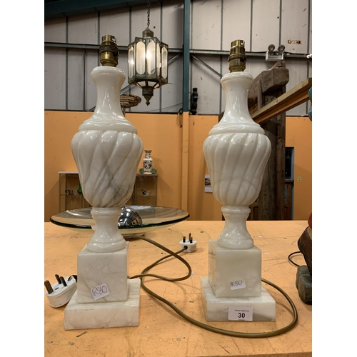 30 - A PAIR OF CARVED MARBLE LAMPS...