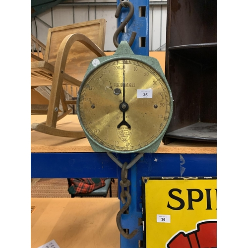 35 - A GREEN METAL AND BRASS SALTER 200LB HANGING WEIGHING SCALES TRADE SPRING BALANCE 235T...