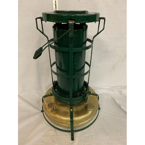 5 - A BRASS AND GREEN PAINTED ALADDIN PINK PARAFFIN STOVE...