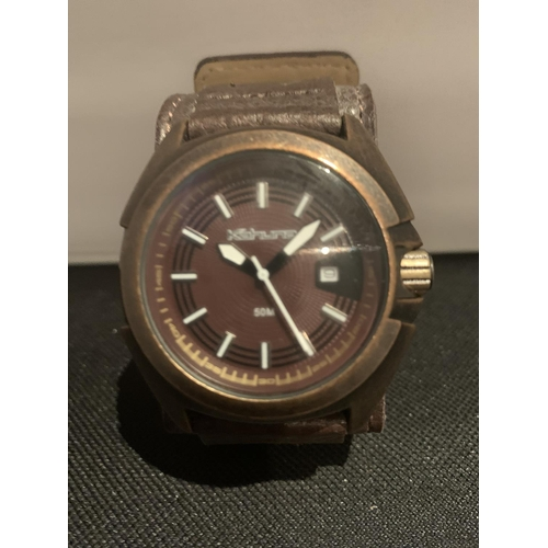 501 - A KAHUNA WRIST WATCH IN WORKING ORDER...