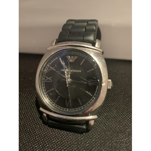 502 - AN EMPORIA ARMANI WRIST WATCH IN WORKING ORDER A/F CRACKED GLASS...