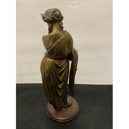 52 - A BRASS GREEK FIGURINE OF A LADY...