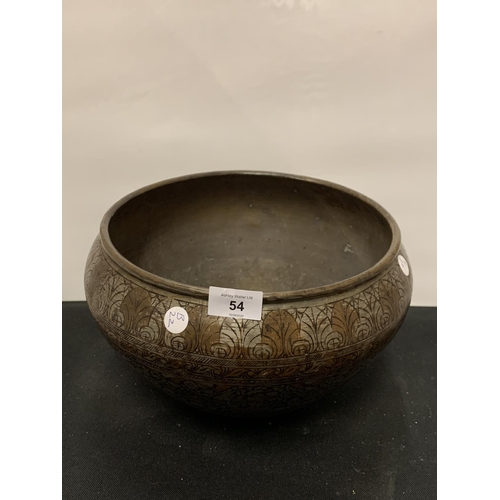 54 - A SILVER AND BRASS METAL PLANT POT...