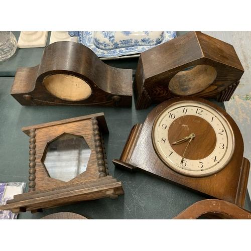 68 - AN ASSORTMENT OF WOODEN MANTLE CLOCK CASES...