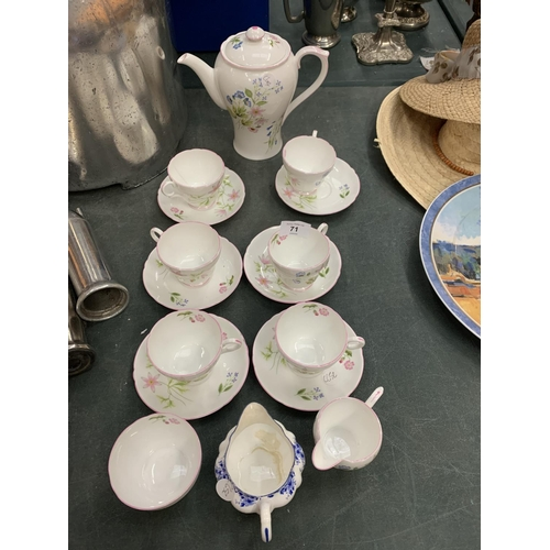 71 - A SHELLEY 'FIELD FLOWERS' COFFEE SET AND A BLUE AND WHITE SHELLEY CREAM JUG...