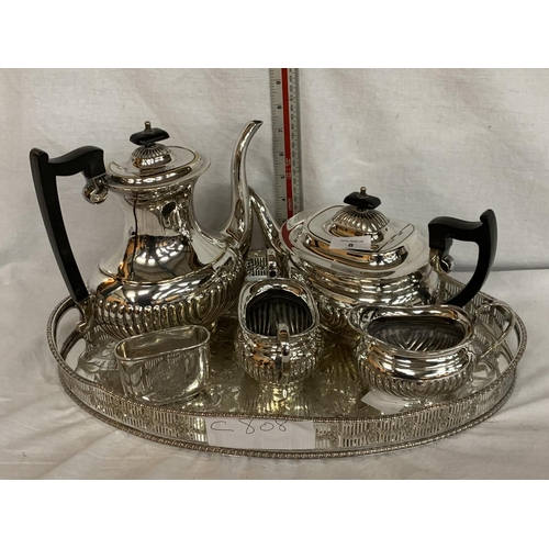8 - A FIVE PIECE SILVER PLATED TEA AND COFFEE SET WITH MATCHING TRAY...