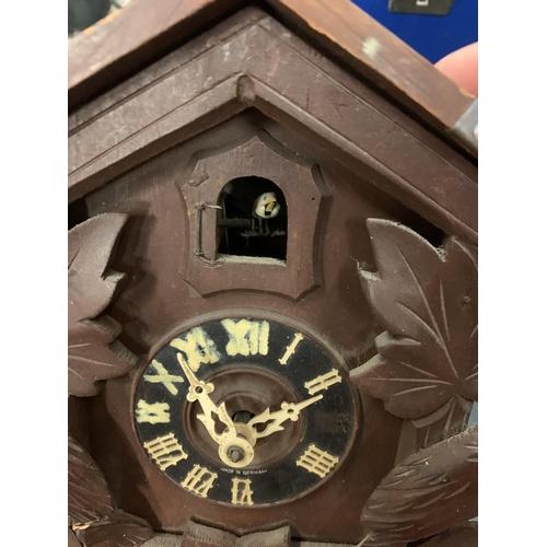 95 - A BAVARIAN STYLE WOODEN CUCKOO CLOCK...