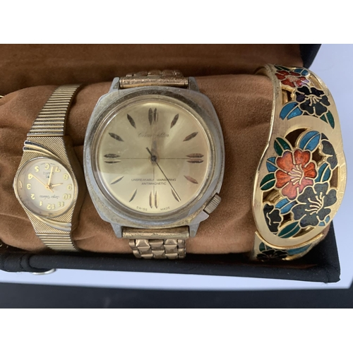 517 - A ROUND WRIST WATCH CASE AND CONTENTS TO INCLUDE FIVE WATCHES AND TWO BANGLES...