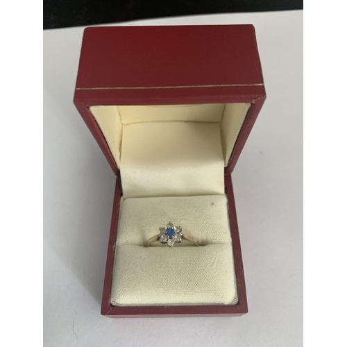 533 - A 9 CARAT GOLD AND SAPPHIRE RING...