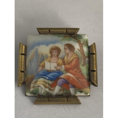 536 - A BRASS HAND PAINTED LIMOGES BROOCH...