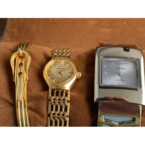 574 - A ROUND WRISTWATCH/BRACELET CASE WITH FIVE VARIOUS WATCHES AND TWO BANGLES...