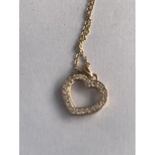 589 - A 9CT GOLD DIAMOND SET HEART PENDANT AND CHAIN, APPROX TOTAL GROSS WEIGHT 1.5 GRAMS...