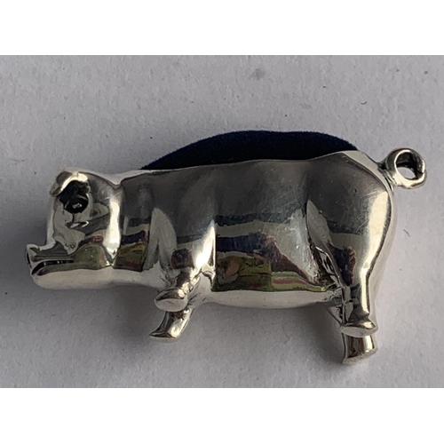 591 - A SILVER PIG PIN CUSHION...