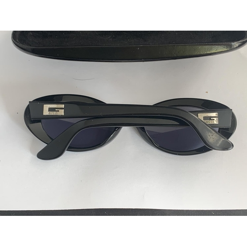602 - A PAIR OF GUCCI SUNGLASSES WITH CASE...
