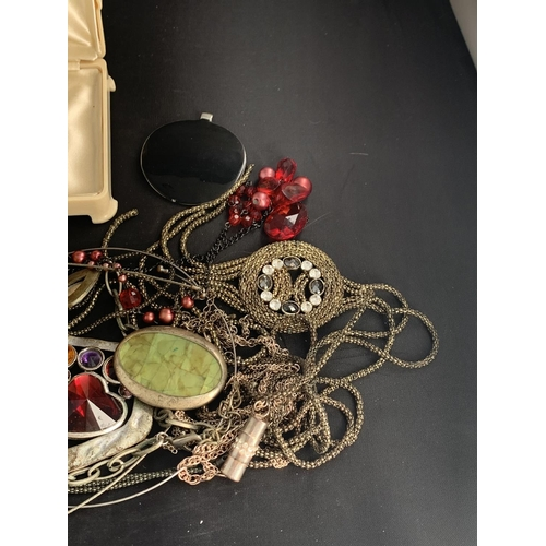 603 - A LARGE QUANTITY OF COSTUME JEWELLERY...