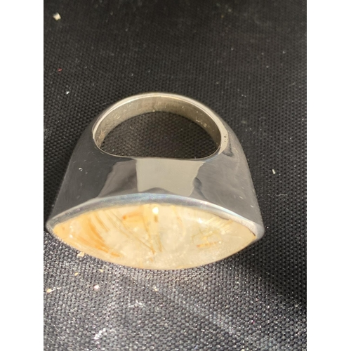 608 - A BOXED WHITE METAL RING WITH STONE...