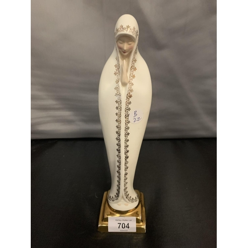 704 - A MIDWINTER MADONA FIGURINE...
