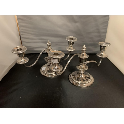 794 - A PAIR OF ORNATE SILVER PLATED CANDELABRAS...