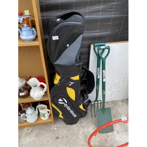 1126 - A TAYLORMADE GOLF BAG AND A SET OF TAYLORMADE GOLF CLUBS...