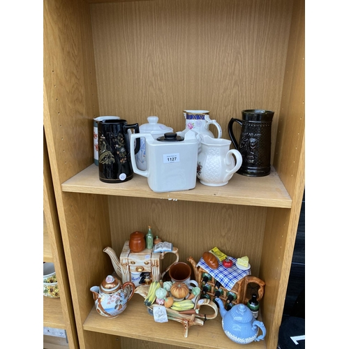 1127 - VARIOUS COLLECTABLE TEAPOTS AND JUGS...
