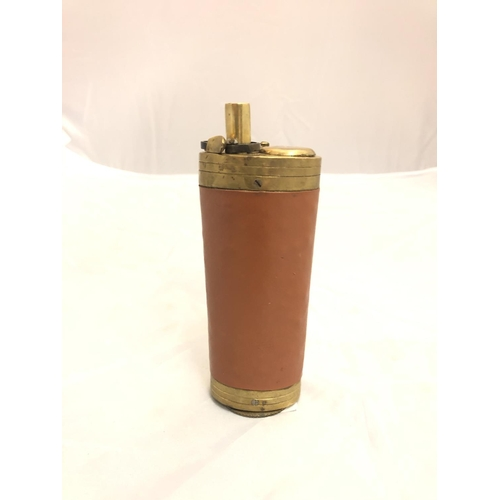 415 - A BRASS AND LEATHER THREE WAY POWDER FLASK...