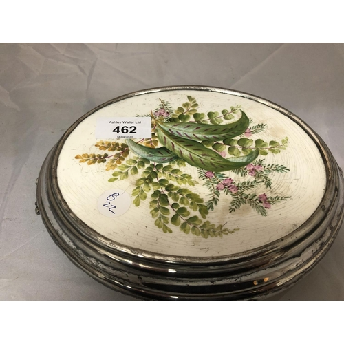 462 - A SILVER PLATED FRAMED CERAMIC PLATE OF WILD FLOWERS TEAPOT STAND...