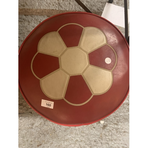 160 - A RETRO RED LEATHER FOOTSTOOL...