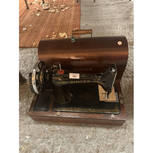 161 - A VINTAGE SINGER SEWING MACHINE WITH WOODEN CARRY CASE...