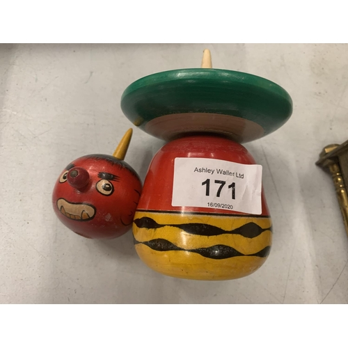 171 - A WOODEN SPINNING TOP IN THE SHAPE OF A CLOWN...