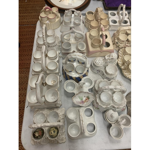 183 - A COLLECTION OF CERAMIC EGG CUPS AND HOLDERS (SEVERAL A/F)...
