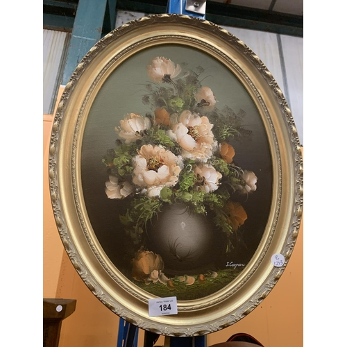 184 - AN OVAL GILT FRAMED PICTURE OF A VASE OF PEONIES BY J COOPER...