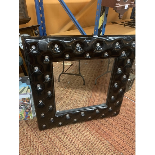 186 - A LARGE SQUARE BLACK AND DIAMONTE FRAMED MIRROR...