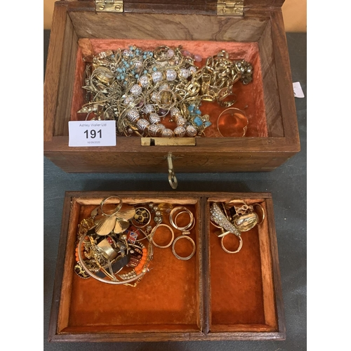 191 - AN INLAID WOODEN JEWELLERY BOX WITH MIRROR, INNER TRAY,KEY AND A LARGE QUANTITY OF COSTUME JEWELLERY...
