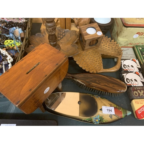 194 - A COLLECTION OF WOODEN AND TREEN ITEMS TO INCLUDE TRAYS, CANDLESTICKS, BOOK ENDS ETC...