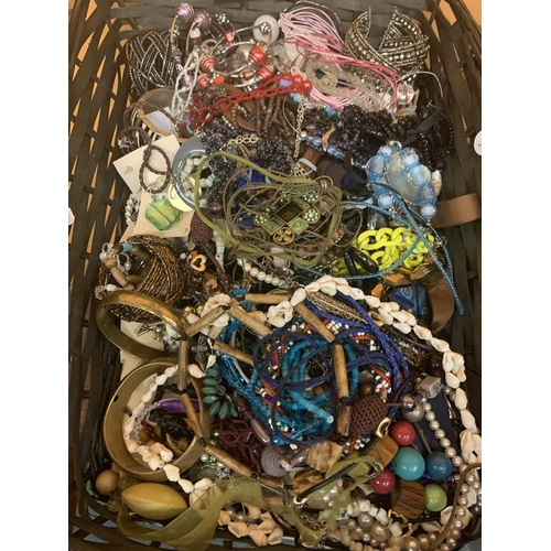 196 - A BASKET CONTAINING A LARGE QUANTITY OF COSTUME JEWELLERY...
