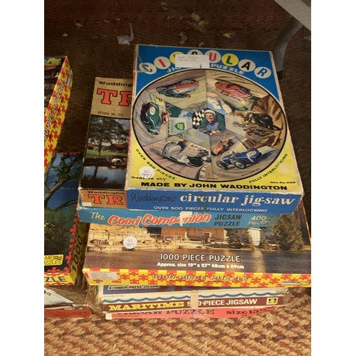 219 - A LARGE QUANTITY OF JIGSAWS AND VINTAGE BOARD GAMES...