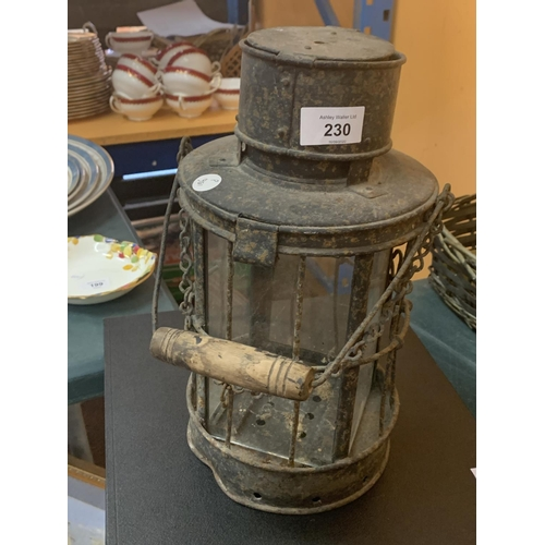 230 - A METAL SMUGGLERS LAMP...