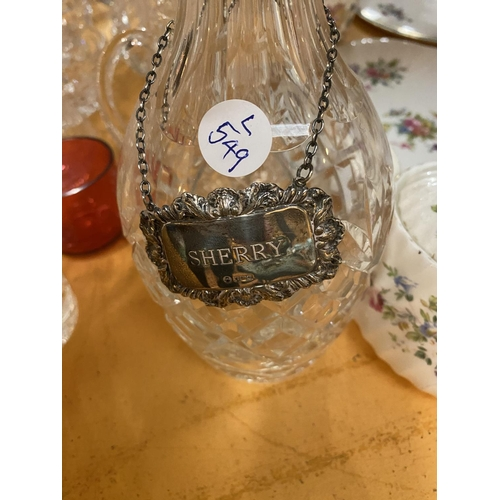 484 - A LARGE COLLECTION OF GLASSWARE TO INCLUDE A SHERRY DECANTER WITH A HALLMARKED SILVER SPIRIT LABEL...