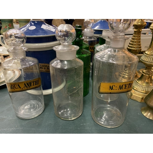 236 - A SELECTION OF GLASS AND CERAMIC CHEMIST JARS WITH NAMES TO INCLUDE A SET OF BOXED CHEMIST SCALES...