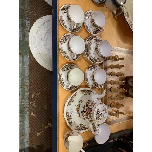 242 - A 'COLCLOUGH' CHINA TEA SET...