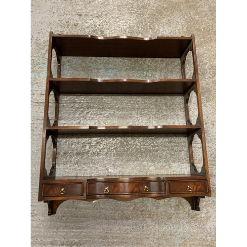 250 - A MAHOGANY FOUR SHELF WALL MOUNTED UNIT WITH THREE LOWER DRAWERS...