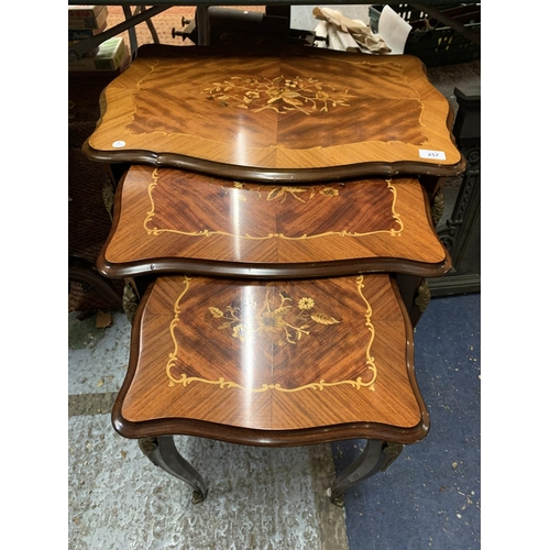 257 - A NEST OF MARQUETRY TABLES...
