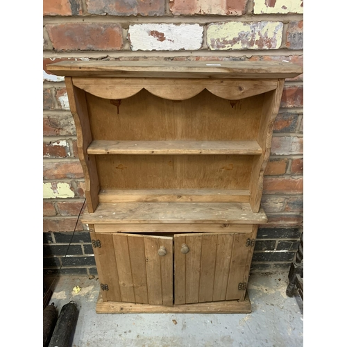 259 - A SMALL PINE WALL DRESSER IN THE ARTS AND CRAFTS STYLE...